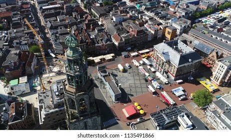 Aerial bird view photo Grote Markt and Martinitoren highest church steeple in city Groningen Netherlands and bell tower of Martinikerk located at north-eastern corner of Grote Markt Main Market Square