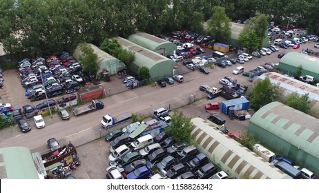 Aerial bird view photo of junkyard is the location of business in dismantling wrecked or decommissioned vehicles their usable parts are sold for use in operating vehicles or for recycling