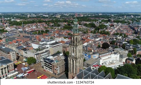 Aerial bird view photo Martinitoren highest church steeple in city of Groningen Netherlands and bell tower of Martinikerk it is located at the north-eastern corner of Grote Markt Main Market Square