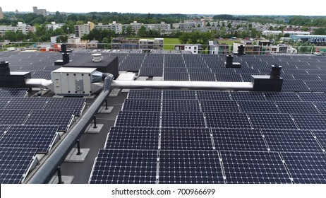 Aerial bird view photo of modern roof filled with solar panels providing sustainable energy or renewable energy by sunlight