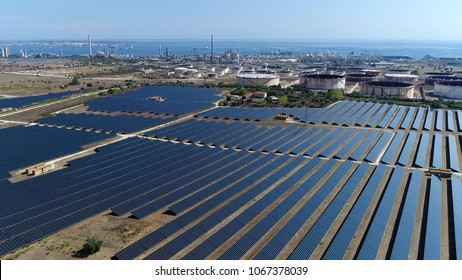 Aerial bird view photo of photovoltaic power station also known as a solar park is large-scale photovoltaic system (PV system) designed for the supply of merchant power into the electricity grid
