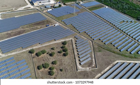Aerial bird view photo photovoltaic power station also known as solar park solar farm or solar ranch is large scale photovoltaic system PV designed for supply of merchant power into electricity grid