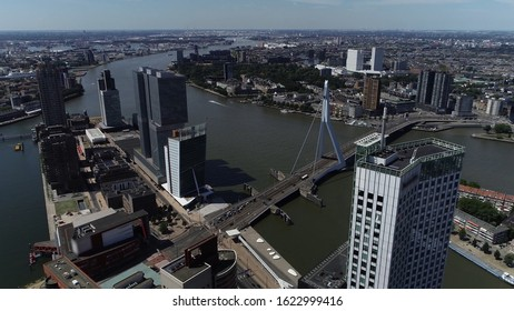 Aerial bird view photo of Rotterdam cityscape showing the Erasmugbrug and the Kop van Zuid on the left and the Noordereiland on right flight past Maastower modern building