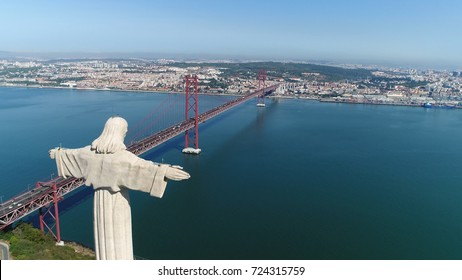 Aerial bird view photo of Sanctuary of Christ the King in Portuguese Santuario de Cristo Rei Catholic monument and shrine dedicated to Sacred Heart of Jesus Christ overlooking city of Lisbon