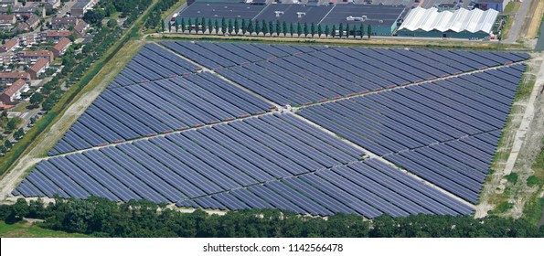 Aerial bird view photo of Solarpark De Mortiere. Located in Middelburg, Zeeland, Holland. The photovoltaic power station supplies the city with green energy.