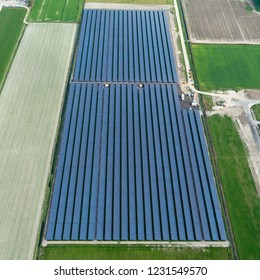 Aerial bird view photo of Solarpark De Vaandel, Located in Heerhugowaard, Noord-Holland, Netherlands. The photovoltaic power station supplies the city with green energy.