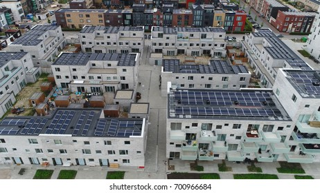 Aerial bird view photo of unfinished new housing project development project showing modern roofs filled with solar panels proving sustainable energy or renewable energy by sunlight
