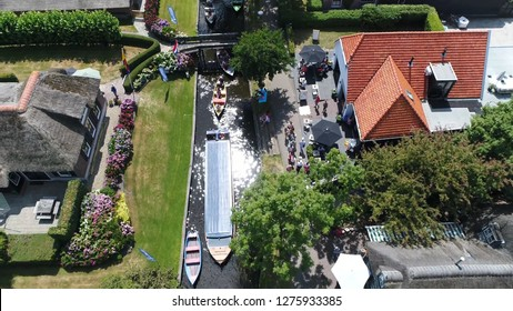 Aerial bird view picture canal in Giethoorn is town in province of Overijssel Holland and is often referred to as the Venice of the Netherlands because of the popular canals with tourist tour boats