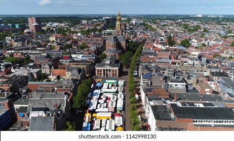 Aerial bird view picture of Groningen city center flight towards AA Church moving over Groningen Markt the marketplace located at shopping street showing the colorful market stand roofs and shops
