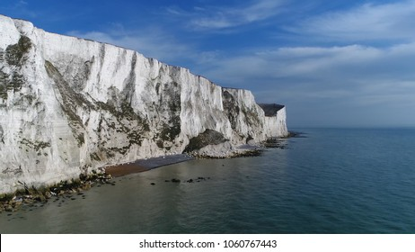 Aerial bird view picture of The White Cliffs of Dover they are cliffs that form part of the English coastline facing the Strait of Dover and France and are part of the North Downs formation