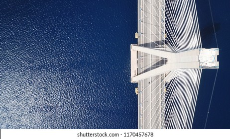 Aerial bird's eye drone photo of state of the art suspension bridge crossing over deep blue sea