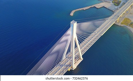 Aerial bird's eye drone photo of state of the art suspension bridge crossing the sea