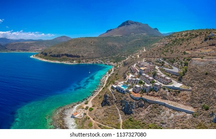 Aerial birds eye panoramic view of the famous village Limeni with amazing colors and crystal water. Laconia, Peloponnese, Greece, Europe