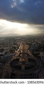 Aerial bird's eye photo of highway and ring road passing through city center on a stormy weather at dusk giving a dramatic effect