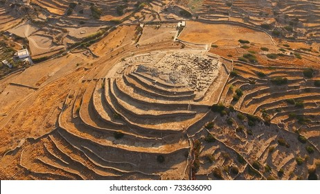 Aerial bird's eye photo of iconic prehistoric settlement of Skarkos, Ios island, Cyclades, Greece