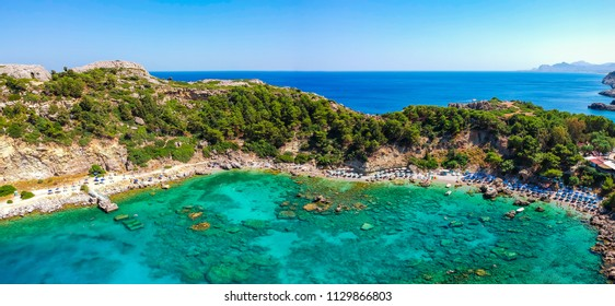 Aerial birds eye view drone photo Anthony Quinn and Ladiko bay on Rhodes island, Dodecanese, Greece. Panorama with nice lagoon and clear blue water. Famous tourist destination in South Europe