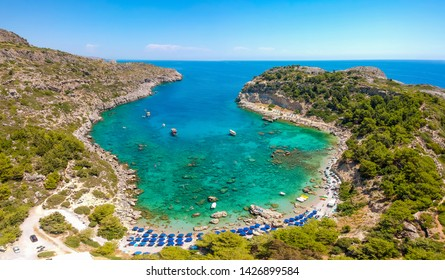 Aerial birds eye view drone photo Anthony Quinn near Ladiko bay on Rhodes island, Dodecanese, Greece. Panorama with nice lagoon and clear blue water. Famous tourist destination in South Europe