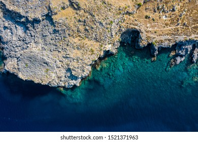 Aerial birds eye view drone photo Saint Paul bay near village Lindos, Rhodes island, Dodecanese, Greece. Sunny panorama with lagoon and clear blue water. Famous tourist destination in South Europe.