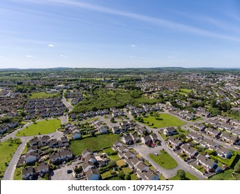 aerial birds eye view of ennis town in county clare ireland. housing estate in a scenic park setting.