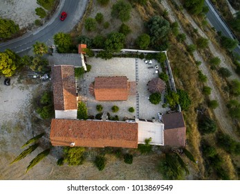 Aerial bird's eye view of Holy monastery of Archangel Michael (Archangelou Michail) in Monagri village, Limassol, Cyprus, an ancient christian religious monument, at sunset, from above.
