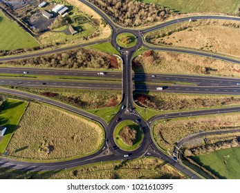 Aerial birds eye view of the M7 motorway in Ireland. Motorway with bridge, roundabouts, and movement.