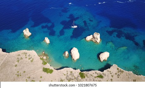 Aerial birds eye view photo taken by drone depicting beautiful deep blue turquoise waters and lovely rocky seascape in Glaronisi islet, Koufonisi island, small Cyclades, Greece