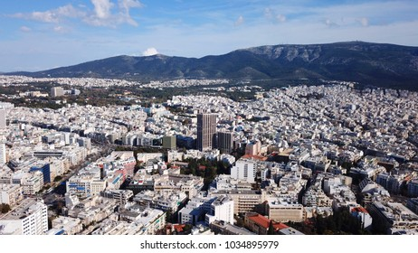 Aerial birds eye view photo taken by drone of iconic city of Athens as seen from Lycabettus hill, Athens historic center, Attica, Greece