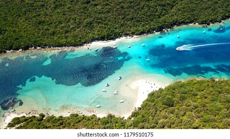 Aerial bird's eye view photo taken by drone of tropical paradise seascape of Sivota with turquoise and sapphire clear waters, Epirus, Greece
