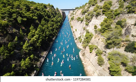 Aerial bird's eye view photo taken by drone of stand up paddle surfing or SUP competition in Corinth Canal of Isthmos or Isthmus, Peloponnese, Greece
