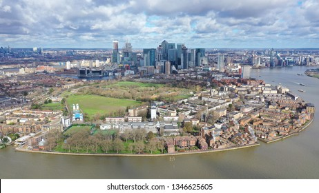 Aerial bird's eye view photo taken by drone of Greenwich park with views to Canary Wharf and University of Greenwich with beautiful cloudy sky, Isle of Dogs, London, United Kingdom