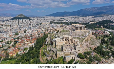 Aerial birds eye view photo taken by drone of iconic Acropolis hill and the Parthenon, Athens historic centre, Attica, Greece