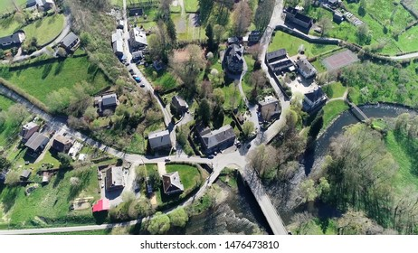 Aerial birds eye view photo of Marcourt a small village in Ardennes Belgium located at the Ourthe river near La Roche en Ardenne beautiful countryside surrounding this town