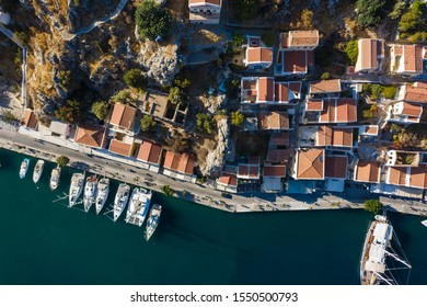 Aerial bird's eye view photo taken by drone of iconic castle of Symi in Ano chora with views to port of Symi island, Dodecanese, Greece.