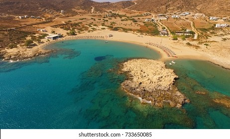 Aerial birds eye view photo taken by drone of famous beach of Manganari, Ios island, Cyclades, Greece