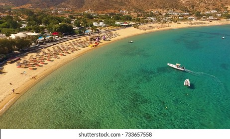 Aerial birds eye view photo taken by drone of famous beach of Mylopotas, Ios island, Cyclades, Greece
