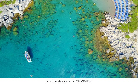 Aerial bird's eye view photo taken by drone of caribbean tropical beach with turquoise - sapphire waters