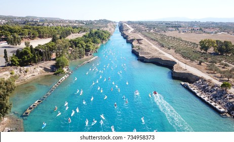 Aerial bird's eye view photo taken by drone of stand up paddle surfing competition or SUP in Corinth Canal of Isthmos referred as SUP crossing 2017, Peloponnese, Greece