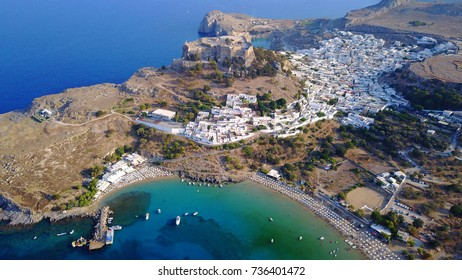 Aerial birds eye view photo taken by drone of iconic Acropolis of village of Lindos, Rhodes island, Dodecanese, Greece