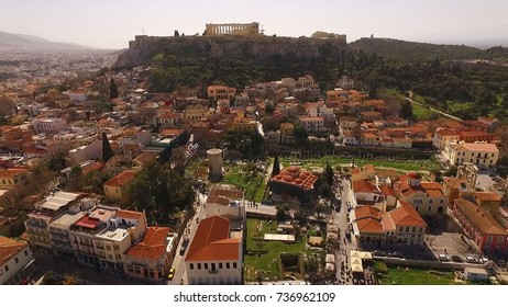 Aerial birds eye view photo taken by drone of iconic Acropolis hill as seen from Plaka district, Athens historic center, Attica, Greece