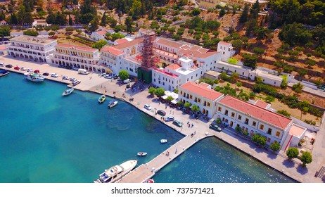 Aerial bird's eye view photo taken by drone of bay and iconic Monastery of Panormitis, Symi island, Dodecanese, Greece