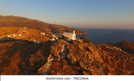 Aerial bird's eye view photo taken by drone of beautiful chora churches in Ios island at sunset, Cyclades, Greece