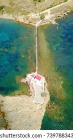 Aerial bird's eye view photo taken by drone of small chapel built in a rock of Agios Isidoros, Leros island, Dodecanese, Greece