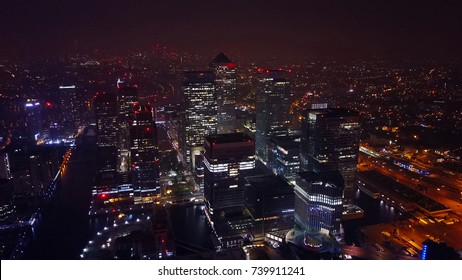 Aerial bird's eye view photo taken by drone of famous Canary Wharf skyscraper complex, Isle of Dogs, London, United Kingdom