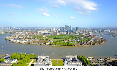 Aerial bird's eye view photo taken by drone of Greenwich park with views to Canary Wharf, Isle of Dogs, London, United Kingdom