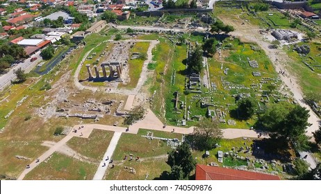 Aerial bird's eye view photo taken by drone of iconic archaeological site of Ancient Corinth, Temple of Apollo, Peloponnese, Greece