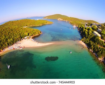 Aerial bird's eye view photo taken by drone of boat in tropical paradise seascape of Sivota with turquoise and sapphire clear waters, Epirus, Greece
