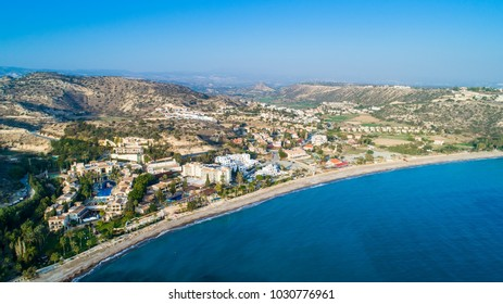 Aerial bird's eye view of Pissouri bay, a village settlement between Limassol and Paphos in Cyprus. Panoramic view of the coast, beach, hotel, resort, hills, plain and building developments from above