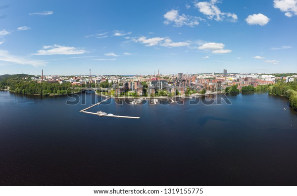 Aerial birds eye view of the Tampere city at sunny summer day in Finland. In the foreground is the new Ratina residential area and on the left the Etelapuisto and Pyynikinharju