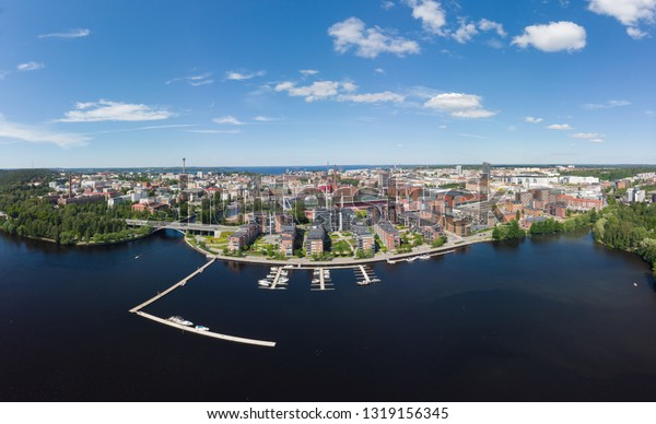 Aerial birds eye view of the Tampere city at sunny summer day in Finland. In the foreground is the new Ratina residential area and on the left the Etelapuisto
