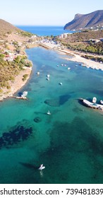 Aerial bird's eye view of turquoise clear water tropical port